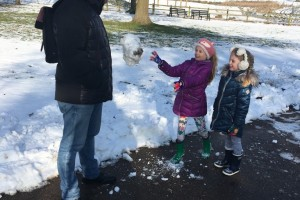Throwing a big snowball at daddy